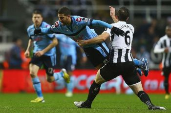 Threat | Adel Taarabt battled with Mike Williamson as he tried to inspire a goal for the visitors. (Image | Daily Mirror)