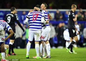 Stalwarts | Clint Hill and Ryan Nelsen embrace after the victory over the Cottagers. (Image | Daily Mail)