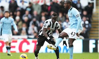 In control | Manchester City midfielder Yaya Toure leads Newcastle United a merry dance at St. James' Park. (Image | The Guardian)
