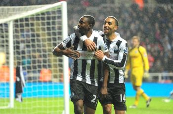 Impact player   Shola Ameobi celebrates with James Perch, who set up his winning goal for Newcastle United yesterday. (Image   Daily Mirror)