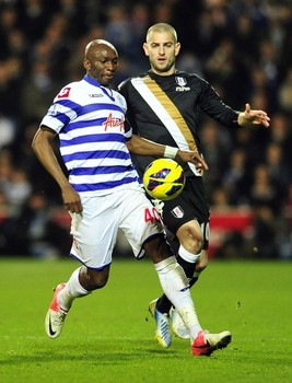 Combative | Stephane Mbia, seen here holding off Mladen Petric, protected the back four against Fulham. (Image | Legal Pro News)