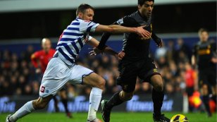 Deadly | Luis Suárez eases past Clint Hill at Loftus Road to score the opener. (Image | BBC)