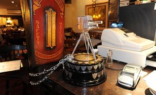 Bar star | Sir Bradley Wiggins' Sports Personality of the Year trophy at the Original Farmers Arms. (Image | The Sun)