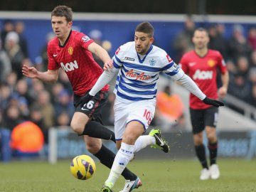 Disappointment | Playmaker Adel Taarabt, seen holding off Michael Carrick, had arguably his worst ever game for the Rs. (Image | Football 365)