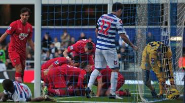 WORD | Queens Park Rangers goalkeeper Júlio César picks the ball out of his net in the 3-1 home defeat to Southampton. (Image | Eurosport)