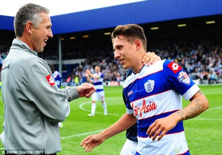 Father and son | Queens Park Rangers goalkeeping coach Kevin Hitchcock congratulates son Tom after he scores the winner against Ipswich Town. (Image | Daily Mail)