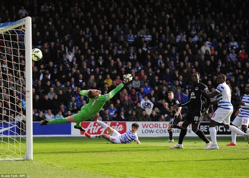 Seamus Coleman fires the ball past Robert Green to give Everton the lead over QPR. (Image | Joe Toth/BPI)