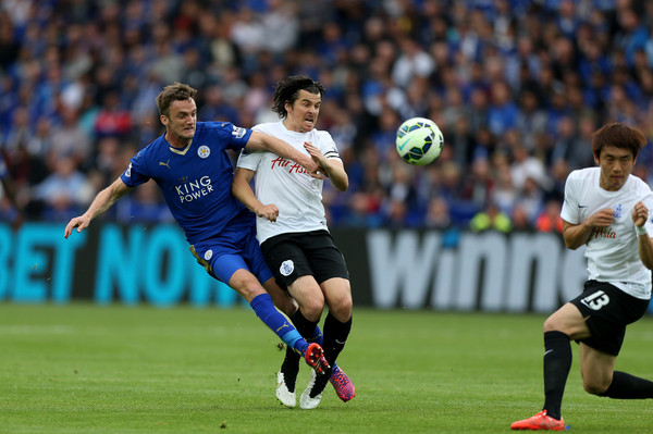 Leicester City's Andy King gets the better of QPR midfielder Joey Barton and Yun Suk-young. (Image | Ben Hoskins/Getty Images Europe)